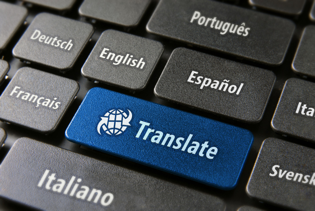 Multilingual translation online concept. Close up of multi language keyboard and translate word key in blue color with clippingpath.
