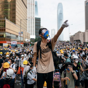 HONG KONG, HONG KONG - JUNE 12:  A protester makes a gesture during a protest on June 12, 2019 in Hong Kong China. Large crowds of protesters gathered in central Hong Kong as the city braced for another mass rally in a show of strength against the government over a divisive plan to allow extraditions to China. (Photo by Anthony Kwan/Getty Images)
